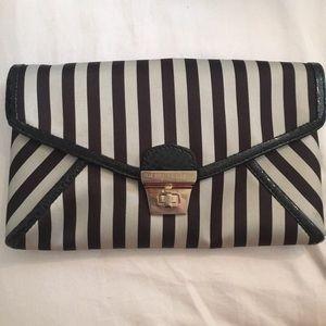 Henri Bendel brown and white stripe clutch